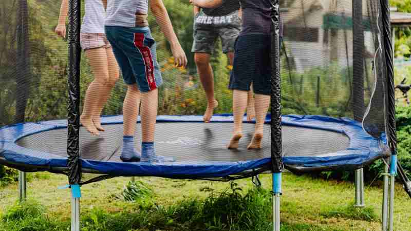 Round trampoline with kids jumping