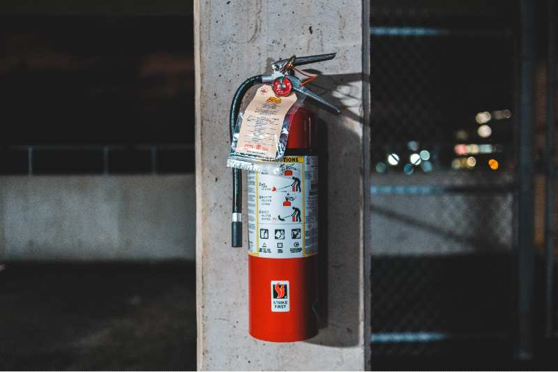 Fire extinguisher on the wall in the event of a space heater fire