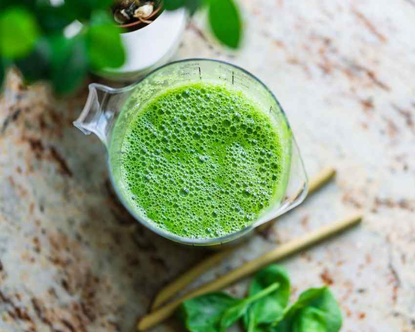 A pitcher with a fresh batch of green juice