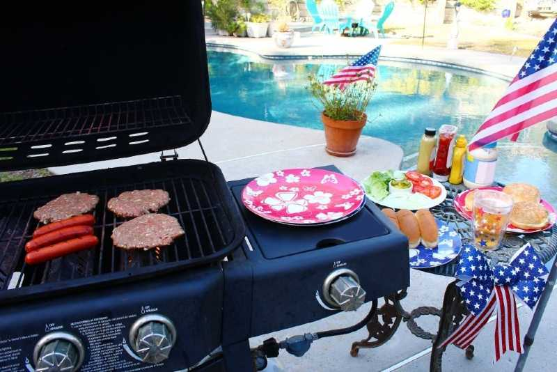 A gas grill with an extra burner