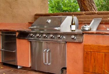large grill built into the outdoor kitchen
