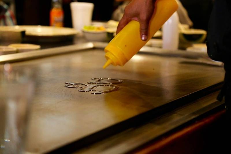 Pouring oil on the cooking surface
