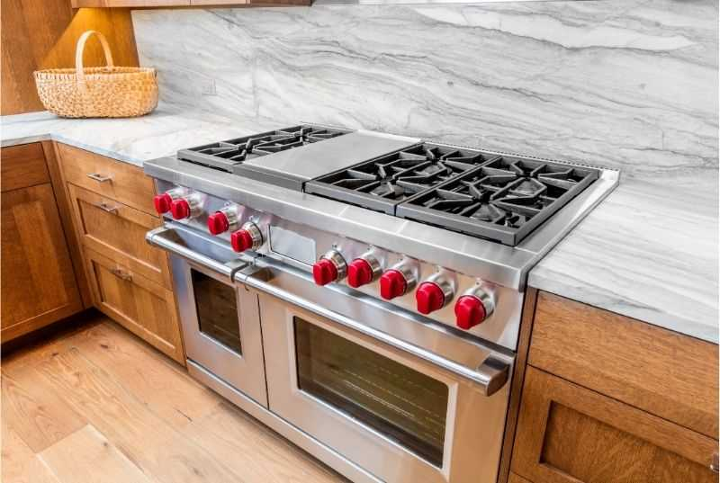 A professional gas range fitted in a home kitchen