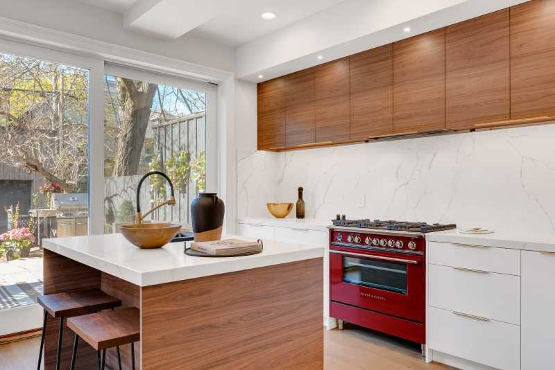 A minimalistic kitchen fitted with a professional gas range