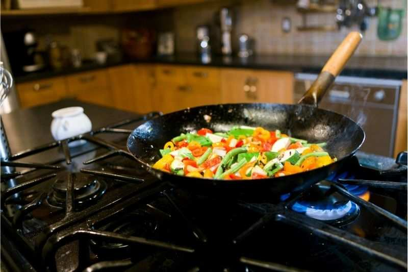 The process of stir frying on a pro-style gas range