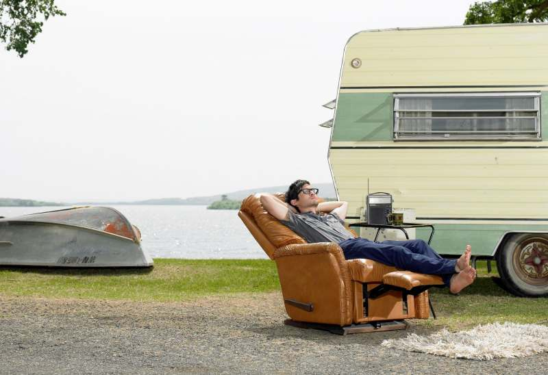 A man relaxing in his Lazy Boy recliner outside
