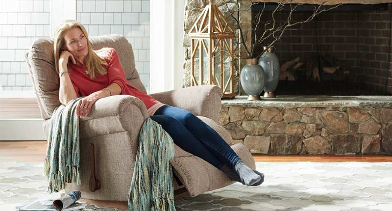 A woman relaxing in a large comfy recliner