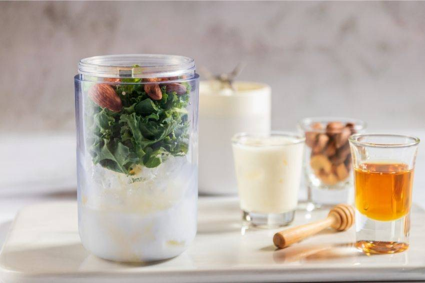 A portable blender cup with healthy ingredients inside