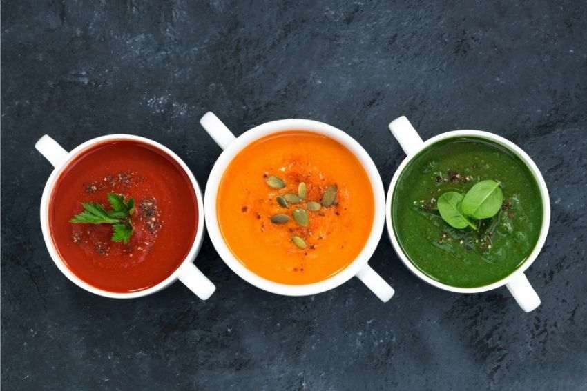Three servings of vegetable soup on the table