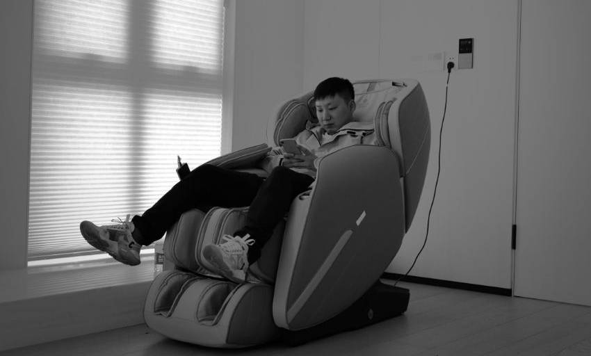 A young boy enjoying free time in a power recliner