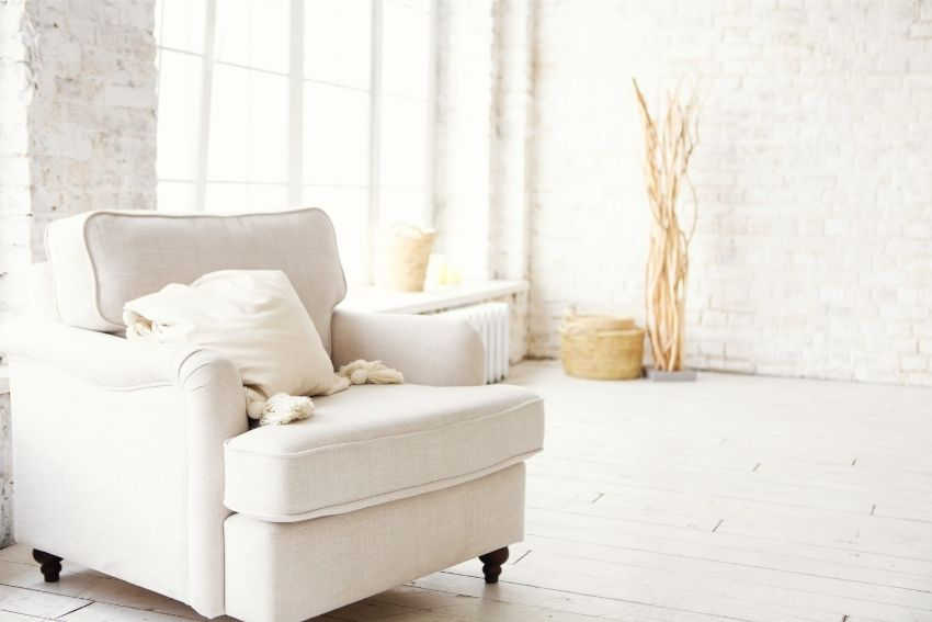 White recliner chair in a large, bright room