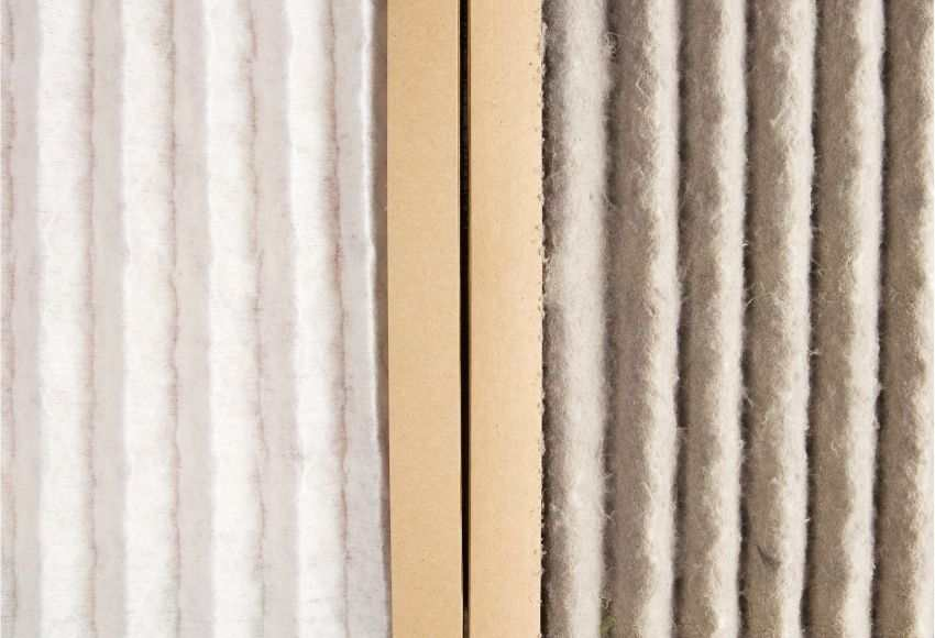 A dirty and a clean AC filter side-by-side