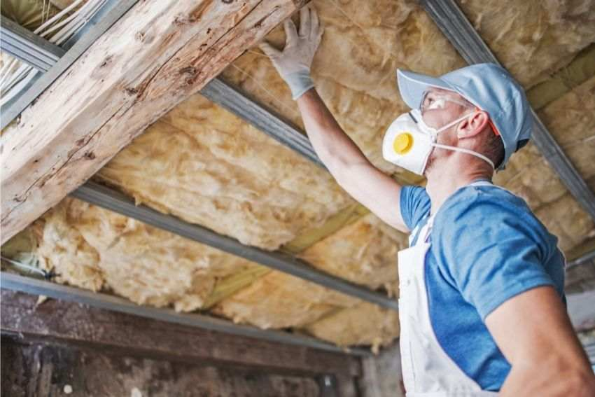 A professional checking on the roof insulation