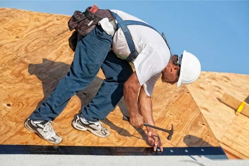 A professional construction worker roofing